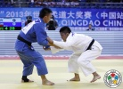 Sheng-Ting Huang (TPE), Yunlong He (CHN) - Grand Prix Qingdao (2013, CHN) - © IJF Media Team, International Judo Federation